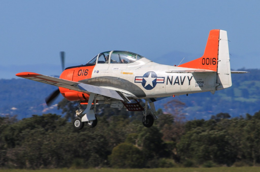 VH-KAN / 140016 North American T-28B Trojan (MSN 219-15 ) operated by AOG Services Pty Ltd, at Jandakot Airport – Sun 3 August 2014. Built in 1955, ex 140016 (US Navy), N46984. Served in the early 1980s with US Navy training squadron VT-27, wearing side number D763 (later changed to G763) and continued with VT-27 until April 1983. VT-27 was the last US Navy training squadron to fly the T-28, later replaced by the Beech T-34C. In April 1984, 140016 was added to US civil aircraft register as N46984, registered to Dennis M Sherman, West Palm Beach, Florida. Registered VH-KAN on 19 February 2014. One of three T-28s now based at Jandakot, it is seen here landing on runway 06L. Photo © David Eyre