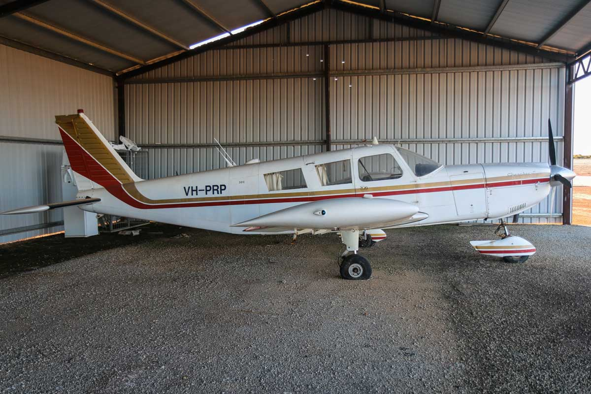 VH-PRP Piper PA-32-300 Cherokee Six (MSN 32-40200) owned by JHC Nominees Pty Ltd of Merredin, WA, at Merredin Airport - Sun 3 August 2014. Built in 1967, this aircraft appears to have been stored in this hangar for some time - note the flat tyre. Photo © David Eyre