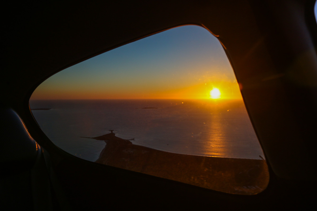 View west towards Garden Island, Carnac Island and Woodman Point from VH-ICE Cirrus SR22 GTS (Gen 5) (MSN 4063) owned by Andrew Dean – Sun 3 August 2014. This Cirrus is brand new (built in 2014). Photo © David Eyre