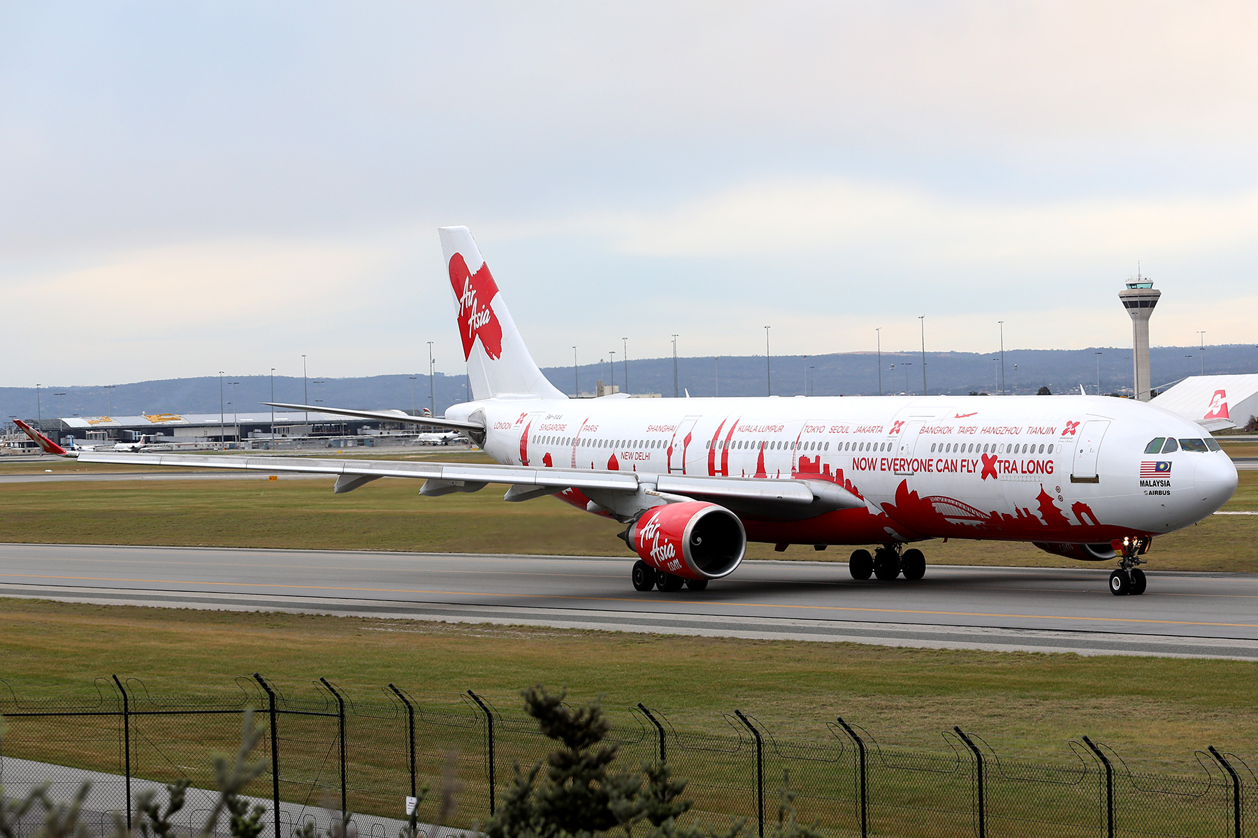 9M-XAA Airbus A330-301 (MSN 054) of AirAsia X, in World Cities special livery, named 'Semangat Sir Freddie', at Perth Airport – Fri 18 July 2014.