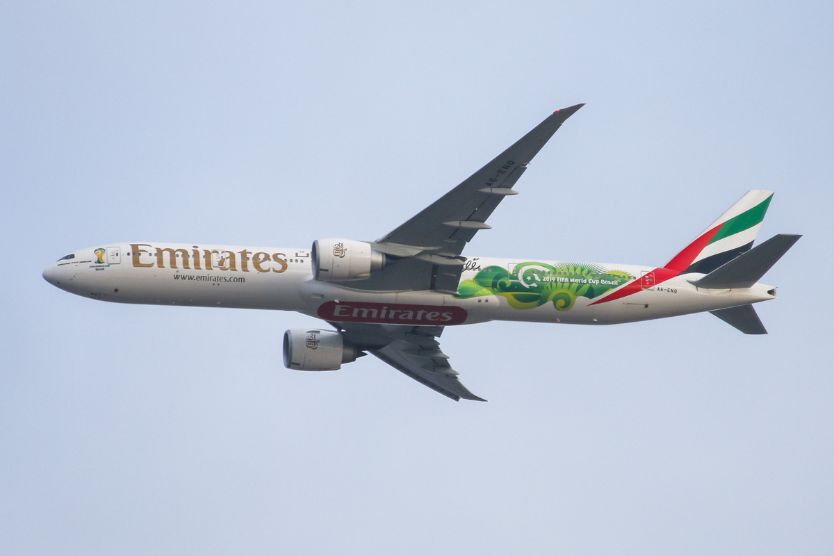 A6-ENQ Boeing 777-31HER (MSN 41363/1201) of Emirates, in special World Cup 'Pele' livery, over the Northern suburbs of Perth - Tue 19 August 2014. Flight EK420 from Dubai, flying north east at 3,100 feet at 5:02pm, before turning right to join the approach to Perth Airport's runway 21. Emirates was an Official FIFA Worldwide Partner for the 2014 World Cup held in Rio de Janeiro and painted three 777-300ERs (the others were A6-ECV and EGE) and one A380 (A6-EEQ) in this special livery featuring the signature of three times World Cup winner, Pelé. This temporary livery was scheduled to be removed three days after this photo. Photo © David Eyre