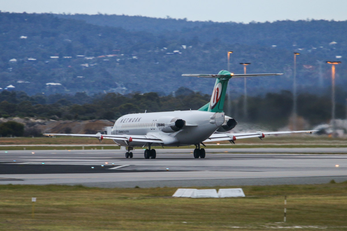VH-NHQ Fokker 100 (MSN 11506) of Network Aviation, at Perth Airport - Tue 2 September 2014. Taking off from runway 06 at 6:45am, on a FIFO charter. Photo © David Eyre