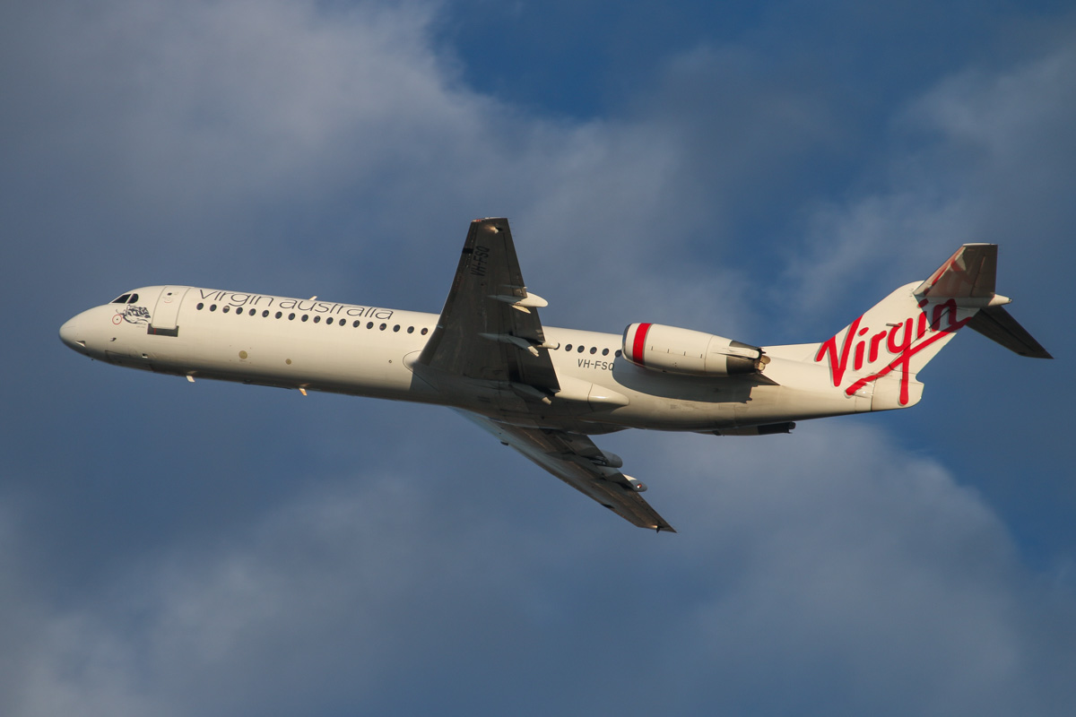 VH-FSQ Fokker 100 (MSN 11450) of Virgin Australia Regional Airlines, named 'Bill's Bay' at Perth Airport - Wed 3 September 2014. Flight VA9319 to Coondewanna, after takeoff from runway 21 at 7:16am. Photo © David Eyre