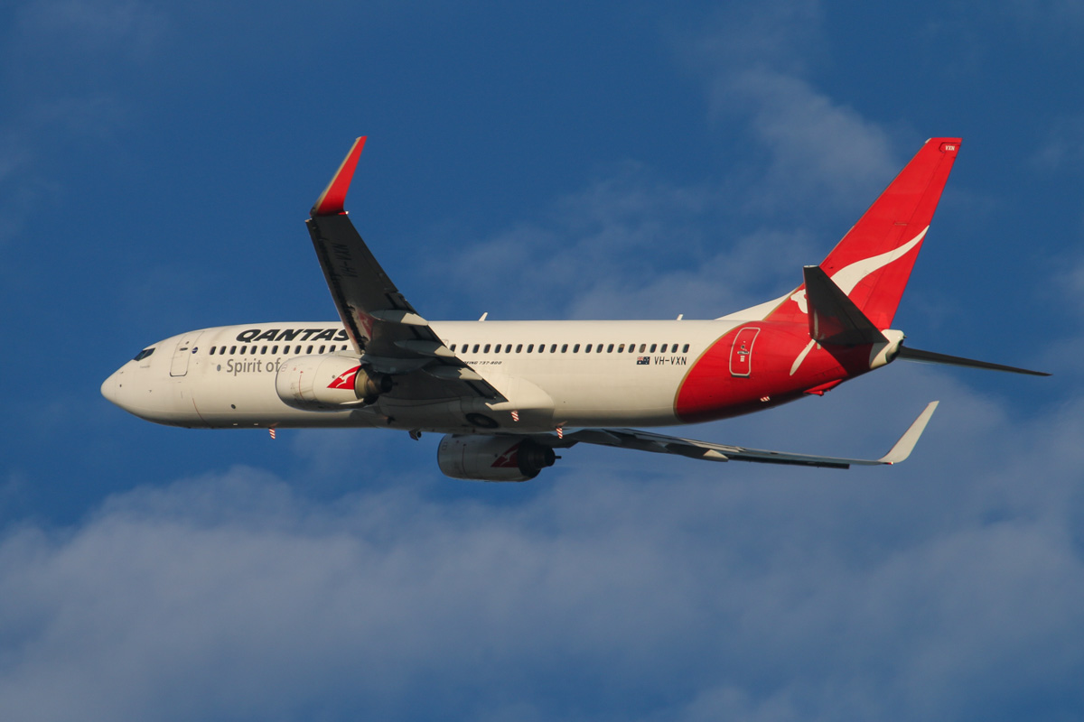 VH-VXN Boeing 737-838 (MSN 33484/1180) of Qantas, named 'Fremantle', at Perth Airport - Wed 3 September 2014. Flight QF900 to Karratha, seen after takeoff from runway 21 at 7:20am. Photo © David Eyre