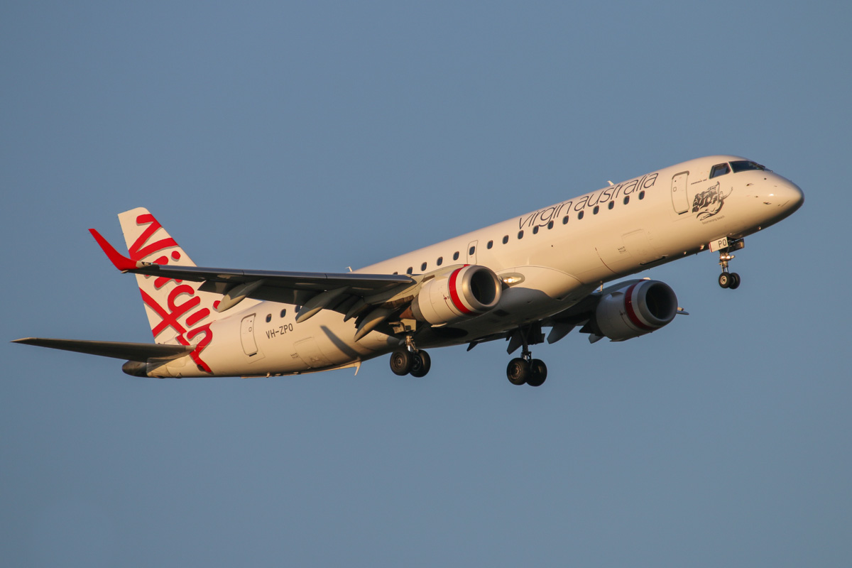 "VH-ZPO Embraer 190AR (ERJ 190-100IGW) (MSN 19000321) of Virgin Australia, named ""Boomerang Beach"", at Perth Airport – Mon 15 September 2014. Flight VA1486 from Broome, on finals to runway 21 at 5:24pm. Photo © David Eyre"