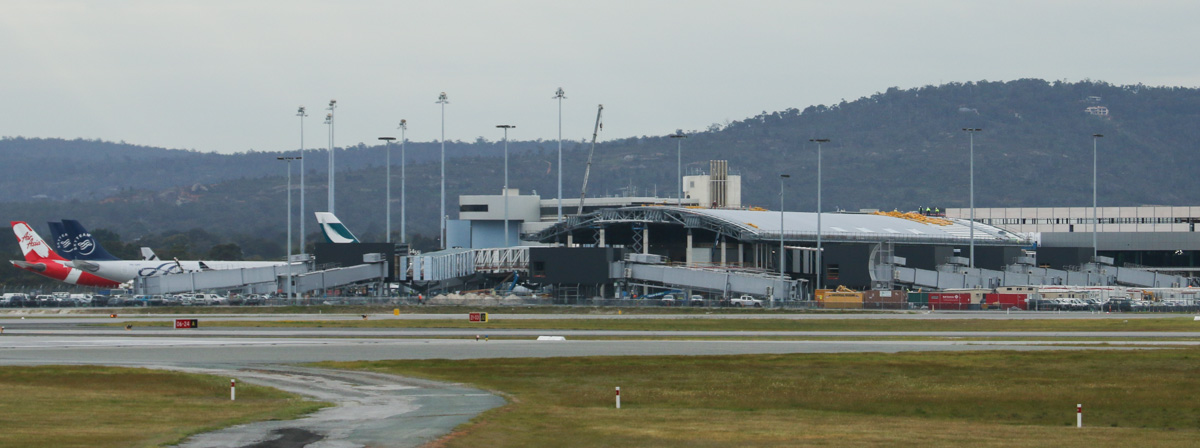 The Virgin Australia Pier at Terminal 1, under construction at Perth Airport - 5 September 2014. Delays in construction have pushed back the opening of the Pier from the original June 2014 to June 2015. Photo © David Eyre