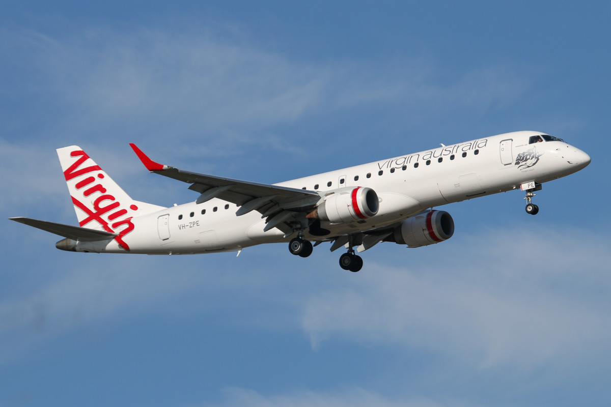 VH-ZPE Embraer 190AR (ERJ-190-100IGW) (MSN 19000187) of Virgin Australia, named 'Coogee Beach', at Perth Airport – Thu 25 September 2014. Flight VA1484 from Broome, on final approach to runway 21 at 4:07pm. Photo © David Eyre