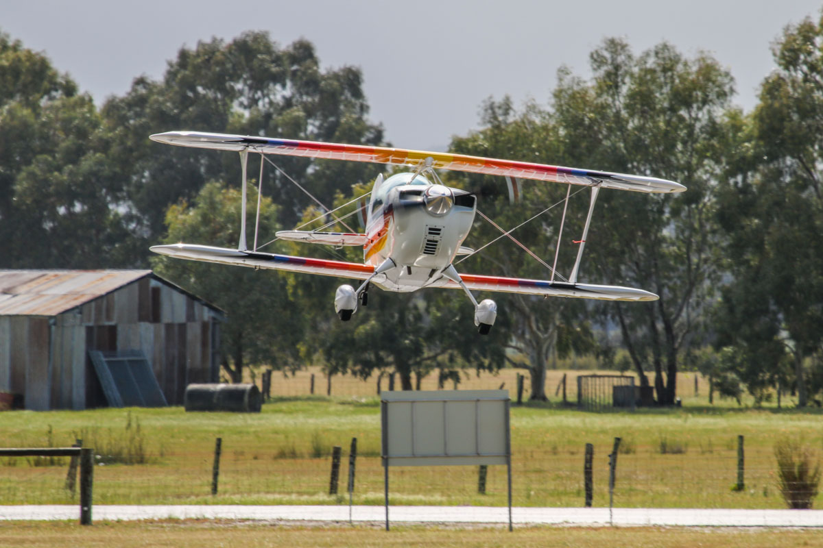 VH-BQO Christen Eagle II (MSN V81) owned by Eagle Magic Pty Ltd and flown by Adam Gibbs, at at SABC Annual Fly In, Serpentine Airfield – Sun 28 September 2014. VH-BQO was built by its first owner in Ballarat, Victoria in 1986 and initially registered VH-BOO. The aircraft was sold to a syndicate from Jandakot, comprising brothers Neill and Ted Rear, Peter Yates, and Kevin Bailey. In 1988 Kevin, sponsored by Rabbit Photos, flew VH-BOO in aerobatic displays at all Australian mainland capital cities, as part of Australia's bicentennial celebrations. On 20 Jan 1989, Peter Yates was flying the Eagle when the original fixed-pitch wooden propeller separated, and he made a perfect forced landed in a paddock 4 miles south of Jandakot. During the 3 months it was out of the sky, it was fitted with a constant speed propeller and the minor damage caused by the prop separation was repaired. CASA had reallocated the registration VH-BOO to another aircraft, so it was registered VH-BQO. In 1995, it was registered to Eagle Magic Pty Ltd. Photo © David Eyre