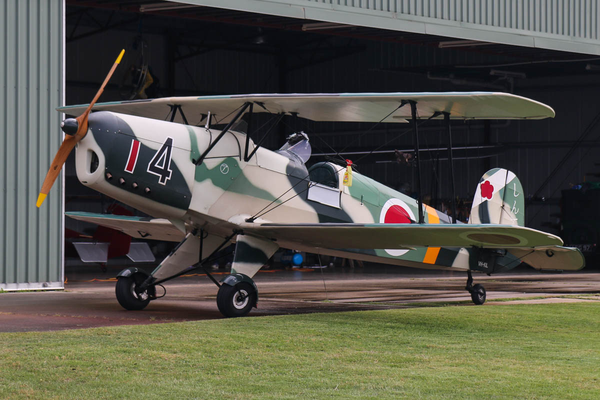 "VH-KIL / 14 CASA 1-131E Jungmann (MSN unknown, ex E3B-295 Spanish Air Force) owned by Bert Filippi, at SABC Annual Fly In, Serpentine Airfield – Sun 28 September 2014. Painted in Imperial Japanese Army Air Service markings to represent a Kokusai Ki-86. The Japanese Navy built 339 Bucker Jungmann as the Kyushu K9W1 Type 2 Momiji and the Japanese Army Air Service built 1,037 as the Kokusai Ki-86. The latter were powered by a Hitachi Ha-47 110 HP 4 cylinder in line engine similar in size to the Lom M 332 powering this aircraft. The Kokusai Ki-86, nicknamed ""Cypress"" by the Americans, was used as a trainer by Imperial Japanese Army Air Force 47th Air Regiment (SHIN-TEN) which defended Tokyo against the B-29 Bombers. None of the original Ki-86 have survived. The MSN for VH-KIL is incorrectly recorded as ""295"", but this is derived from its Spanish Air Force serial number. Spanish Jungmanns had MSNs in the 1000 and 2000 ranges. VH-KIL was built in 1940. The origin of this aircraft is a consignment of CASA 1-131E components imported to the USA by Marcus Bates in Odessa, Texas, USA from the Spanish Military. The aircraft was restored over a period of 10 years, and all replacement parts were built in accordance with approved drawings by Joe Krybus of Krybus Aviation in Santa Paula, California. Registered 11.11.2008 to Bert Filippi. Photo © David Eyre"