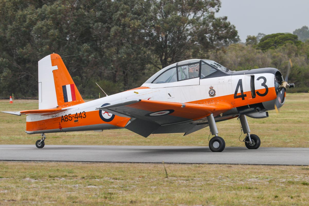 "VH-NTJ / ""A85-443"" CAC CA-25 Winjeel (MSN CA25-07) of Tang Holdings Pty Ltd, at SABC Annual Fly In, Serpentine Airfield – Sun 28 September 2014. The Winjeel was designed and built in Australia as a basic trainer to replace the Tiger Moth and CAC Wirraway. The Wirraway served from the early 1950s until they were replaced by the NZAI CT-4A Airtrainer from 1975. VH-NTJ is actually A85-407, painted to represent A85-443. A85-407 was originally delivered to the RAAF in November 1955, serving with 1 FTS as a basic trainer and later saw service as a Forward Air Controller aircraft with 2OCU and 76 Squadron at Williamtown, NSW before being used as an instructional airframe at the RAAF School of Technical Training (RSTT), Wagga, NSW. It was sold to Winrye Aviation in 1989 and painted to represent the only Winjeel to be painted in orange/white 'Fanta Can' livery, A85-443. In 2000, it was sold to Ron Peters and George Baumanis, who both flew in this aircraft when they did their RAAF pilot training in 1969. Photo © David Eyre"