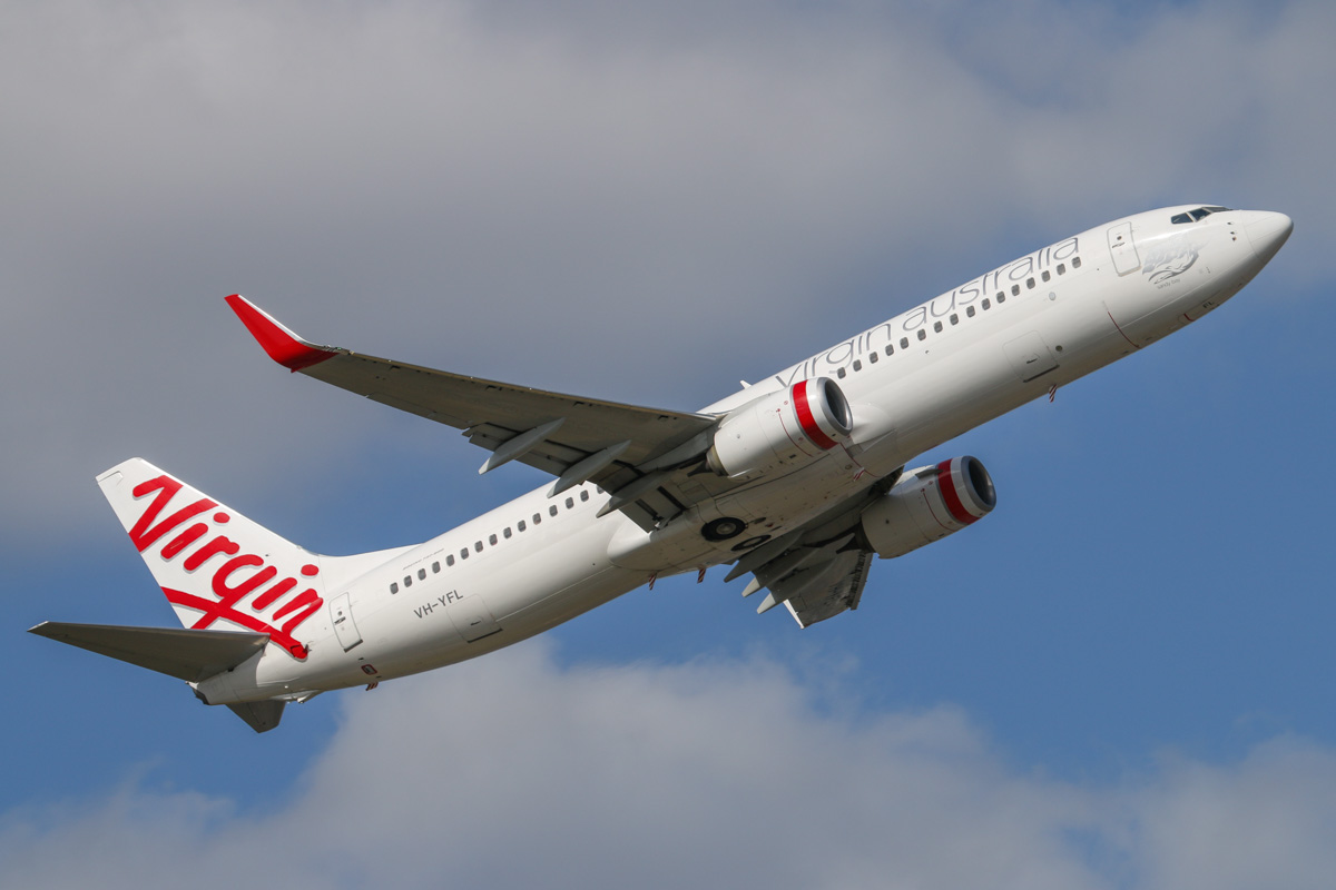 VH-YFL Boeing 737-8FE (MSN 41002/4047) of Virgin Australia, named 'Sandy Bay', at Perth Airport - Mon 6 October 2014. Flight VA1487 to Broome, after takeoff from runway 21 at 3:24pm. Photo © David Eyre