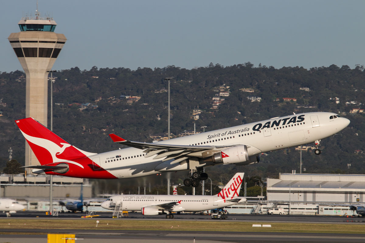 VH-EBM Airbus A330-203 (MSN 1061) of Qantas, named 'Tamar Valley', at Perth Airport - Tue 7 October 2014. Taking off from runway 21 at 5:32pm as QF776 to Melbourne, with the control tower and hills of the Darling Range in the background. Photo © David Eyre