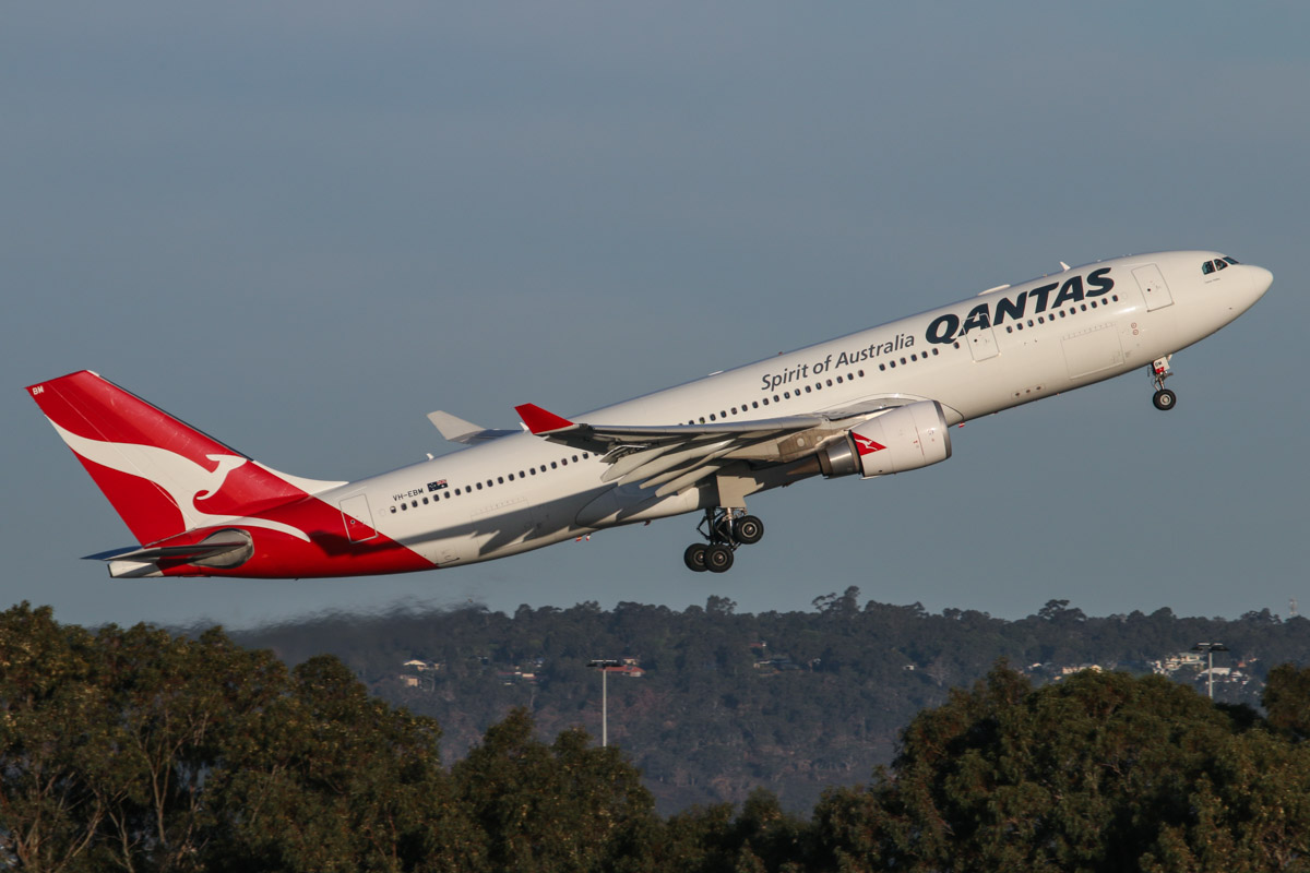 VH-EBM Airbus A330-203 (MSN 1061) of Qantas, named 'Tamar Valley', at Perth Airport - Tue 7 October 2014. Taking off from runway 21 at 5:32pm as QF776 to Melbourne, with the hills of the Darling Range in the background. Photo © David Eyre