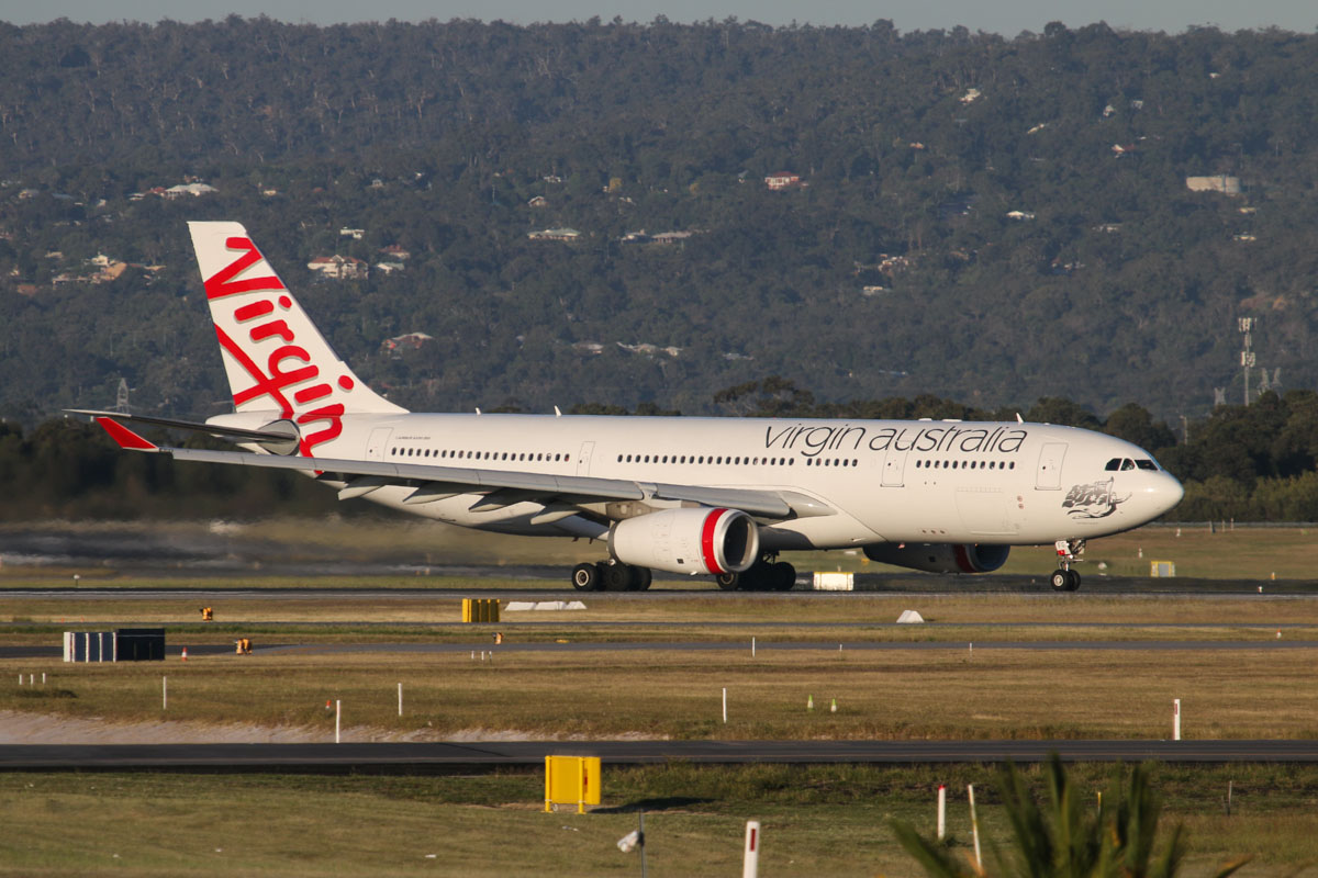 VH-XFG Airbus A330-243 (MSN 1407) of Virgin Australia, named 'Terrigal Beach' at Perth Airport - Tue 7 October 2014. Taking off from runway 21 at 5:42pm as VA694 to Melbourne, with the hills of the Darling Range in the background. Photo © David Eyre