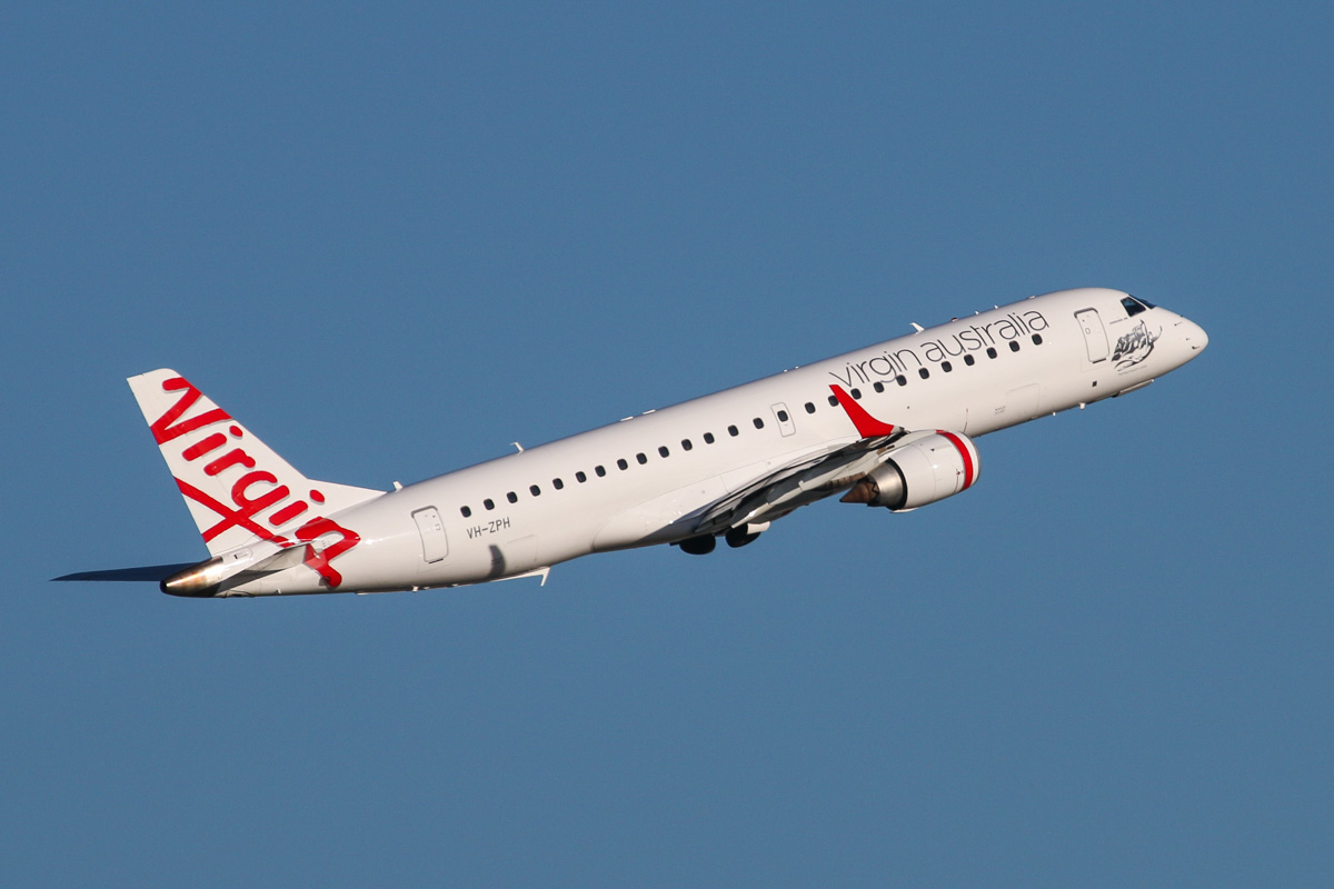 VH-ZPH Embraer 190AR (ERJ-190-100IGW) (MSN 19000199) named 'Honeymoon Cove', of Virgin Australia, at Perth Airport – Tue 7 October 2014. Flight VA720 to Adelaide, after taking off from runway 21 at 5:07pm. Photo © David Eyre