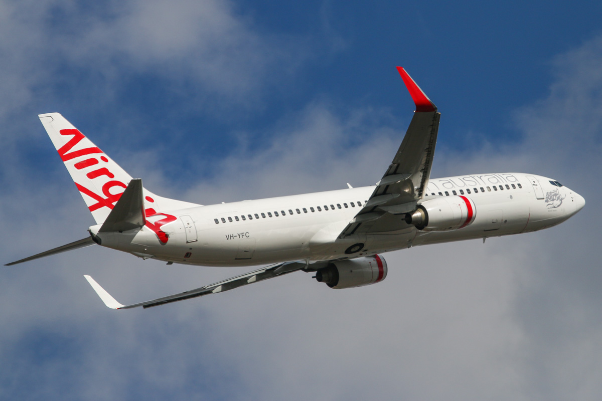VH-YFC Boeing 737-8FE (MSN 39413/3592) of Virgin Australia, named 'Bondi Beach', at Perth Airport – Wed 22 October 2014. Flight VA1843 to Port Hedland, after takeoff from runway 21 at 3:23pm. Photo © David Eyre