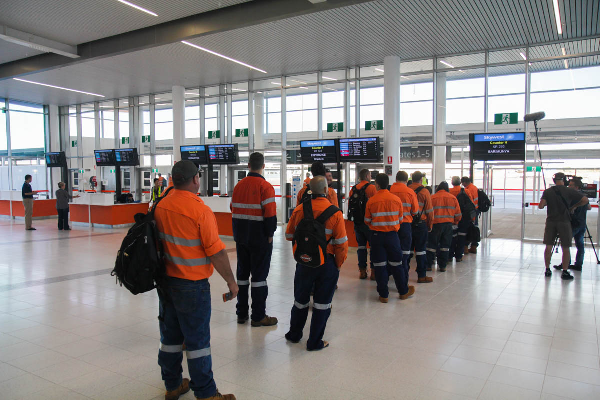Terminal 2 on the first day of operations, Perth Airport - Sat 2 March 2013. Mining workers waiting in the departure gate for a FIFO (Fly In, Fly Out) flight to Barimunya in the Pilbara region of Western Australia, serving BHP Billiton's Yandi iron ore mine. Photo © David Eyre