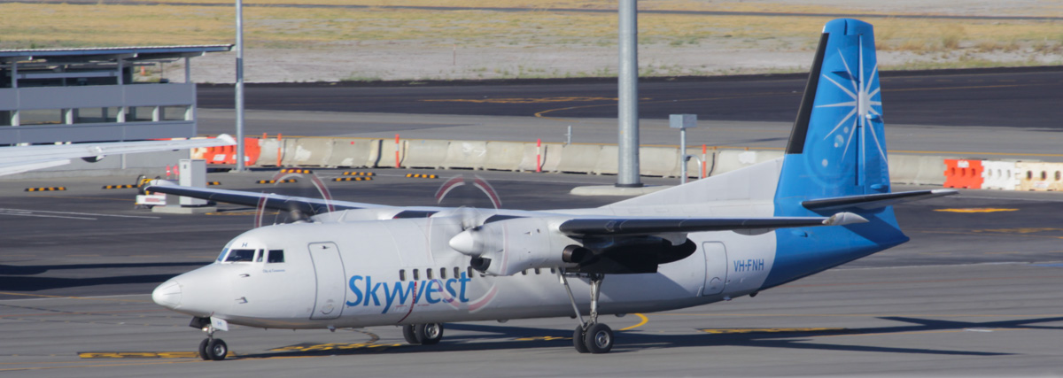 First aircraft to arrive at newly-opened Terminal 2, Perth Airport– Sat 2 March 2013: VH-FNH Fokker 50 (MSN 20113) of Skywest, named 'Shire of Carnarvon'. Taxying in after landing on runway 21 at 8:01am, as flight XR114 from Geraldton. Photo © David Eyre