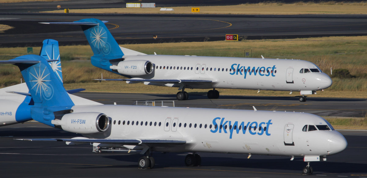 First aircraft and first departure to use the newly-opened Terminal 2 at Perth Airport: VH-FZO Fokker 100 (MSN 11305) of Skywest, departing to Barimunya as XR295 at 07:23. VH-FSW and VH-FNB parked in foreground. Photos © David Eyre