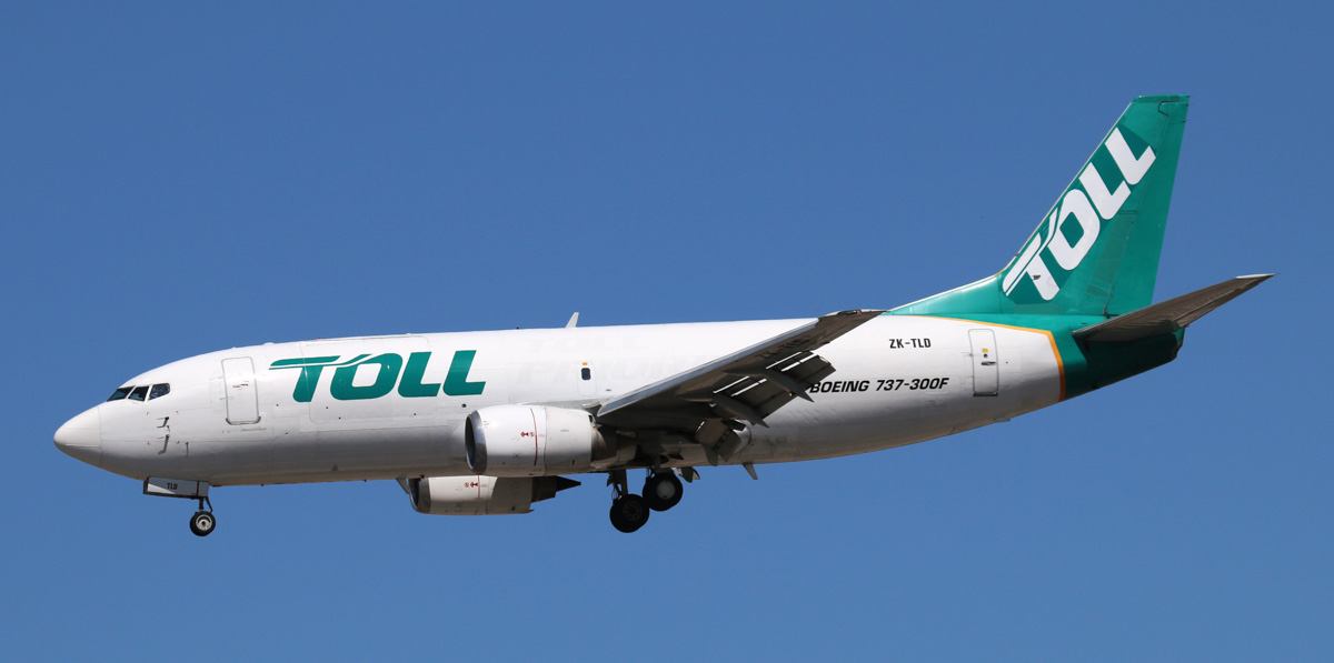 ZK-TLD Boeing 737-3B7(SF) (MSN 23706/1499) of Toll Air Freight (Airwork New Zealand) at Perth Airport - Sat 1 November 2014. 'TOLL 15' from Cocos Island, landing on runway 03 at 2:13pm. Photo © Steve Jaksic