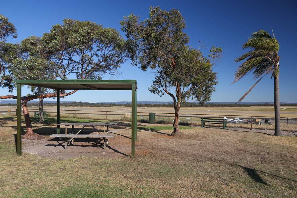 Public Viewing Area at Jandakot Airport - Fri 14 November 2014. View east, across the taxiway, runway 06L/24R and 06R/24L. Photo © David Eyre