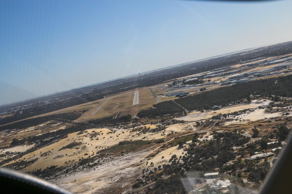 Turning to approach runway 24R at Jandakot Airport, seen from VH-LZJ SOCATA TBM 900 (MSN 1016) owned and flown by Jean-Jacques Bely, – Fri 14 November 2014. Photo © David Eyre