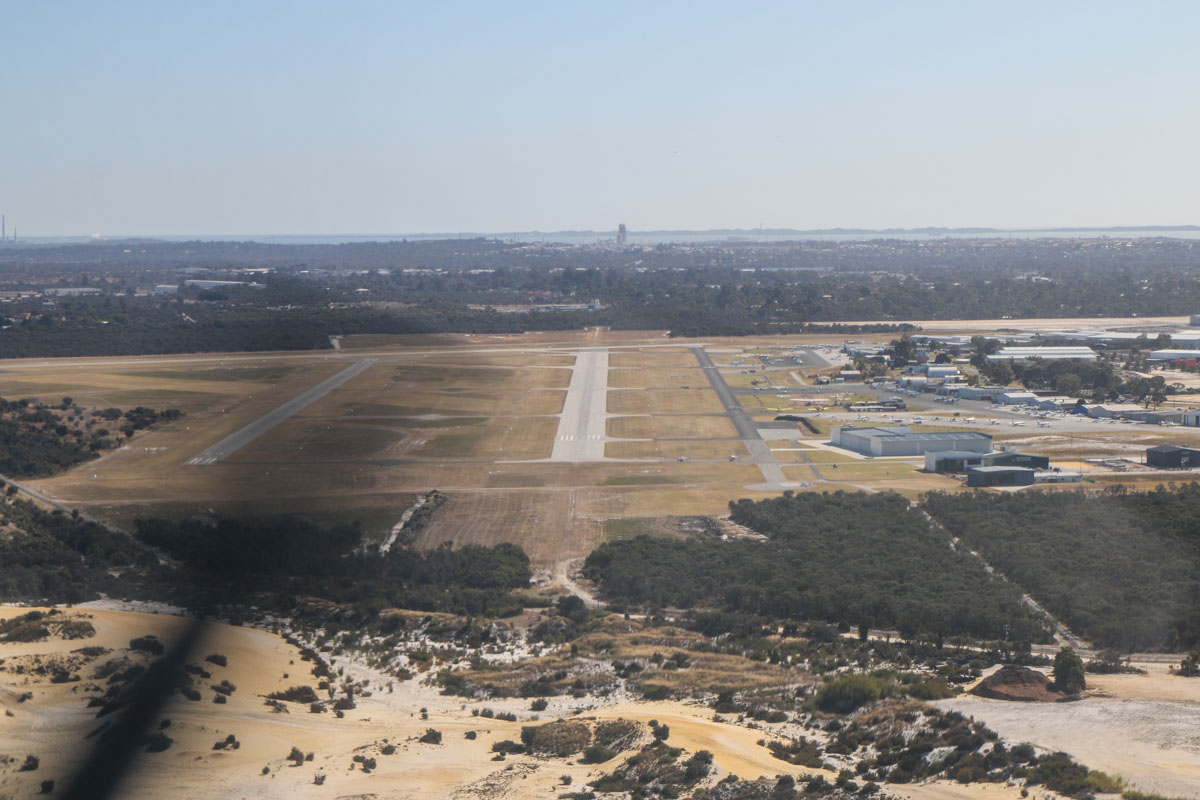 On approach to runway 24R at Jandakot Airport, seen from VH-LZJ SOCATA TBM 900 (MSN 1016) owned and flown by Jean-Jacques Bely, – Fri 14 November 2014. Photo © David Eyre