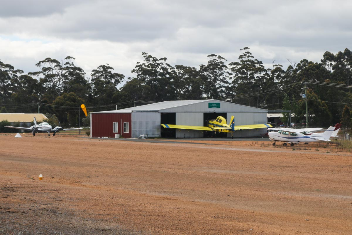 Manjimup Airfield, seen from VH-LZJ SOCATA TBM 900 (MSN 1016) owned and flown by Jean-Jacques Bely – Fri 14 November 2014. Visible (left to right) are: VH-MCB Beech Baron 58 (MSN TH-1475) owned by Lester Northey, of South Bunbury, WA. VH-DUQ / BOMBER 601 Air Tractor AT-802 (MSN 802-0241) of Dunn Aviation, named 'Ballidu'. VH-TEV Cessna 210L Centurion II (MSN 21061374) of JKatherine Aviation Pty Ltd, Katherine, NT. VH-BYC Cessna 182Q Skylane (MSN 18265412) owned by Phillip O'Meehan, Borden, WA. Photo © David Eyre