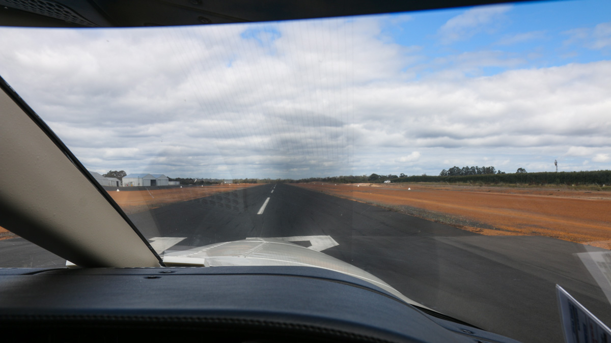 Runway 12 at Manjimup Airfield, seen from VH-LZJ SOCATA TBM 900 (MSN 1016) owned and flown by Jean-Jacques Bely – Fri 14 November 2014. About to take off again, 5 minutes after landing, returning to Jandakot. Photo © David Eyre