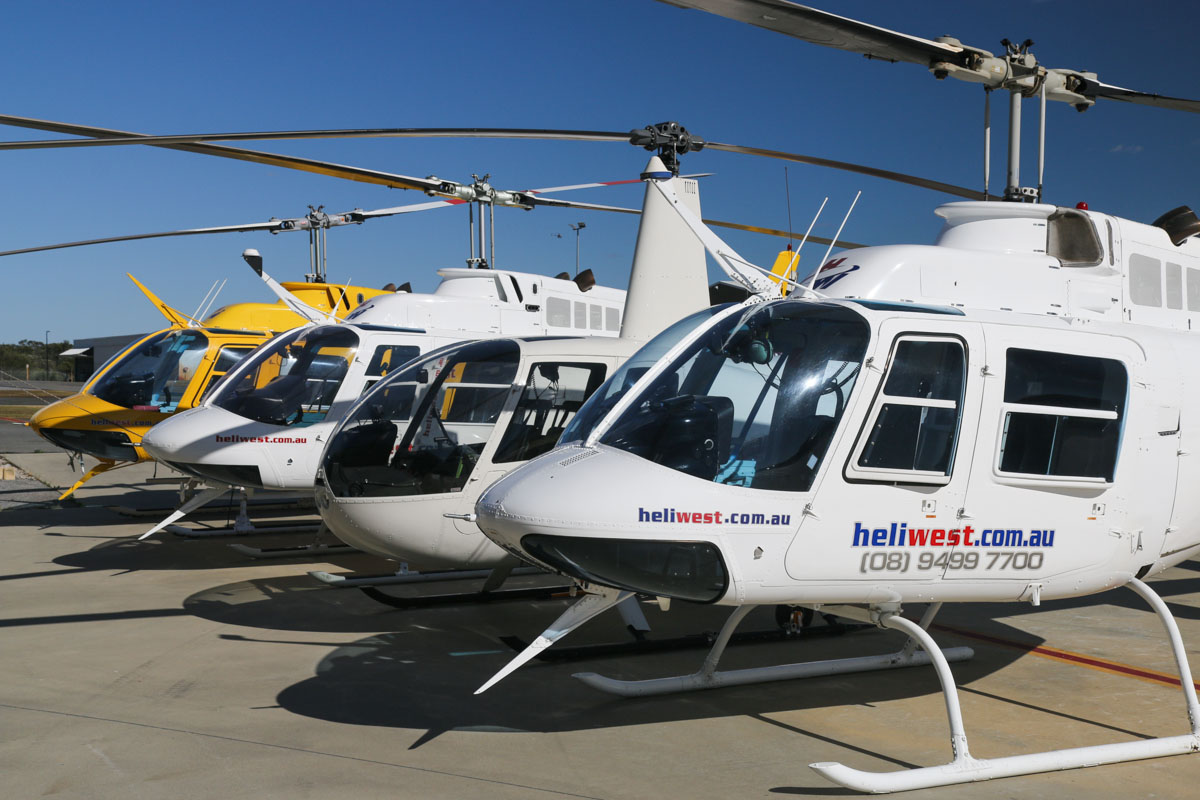 VH-BIN (MSN 2019) & VH-BEL (MSN 851) & VH-VJG (MSN 2169) Bell 206B JetRanger II and VH-ZGY Robinson R44 Raven II (MSN 12491) of HeliWest at Jandakot Airport - Fri 14 November 2014. VH-BIN: Built in 1976, ex N9951K, VH-KHB, VH-UEE. Previously contracted to Surf Life Saving WA as a beach patrol helicopter - still wears the yellow livery. VH-BEL: Built in 1972, ex ZS-HDS. VH-VJG (nearest to camera): Built in 1977, ex 9M-AVM. VH-ZGY: Built in 2008. Photo © David Eyre