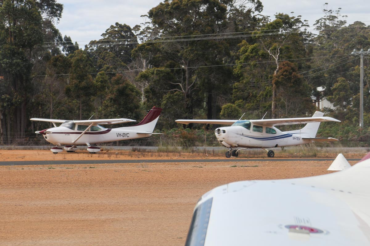 VH-TEV Cessna 210L Centurion II (MSN 21061374) of JKatherine Aviation Pty Ltd, Katherine, NT, and VH-BYC Cessna 182Q Skylane (MSN 18265412) owned by Phillip O'Meehan, Borden, WA, at Manjimup Airfield, seen from VH-LZJ SOCATA TBM 900 (MSN 1016) owned and flown by Jean-Jacques Bely – Fri 14 November 2014. Photo © David Eyre