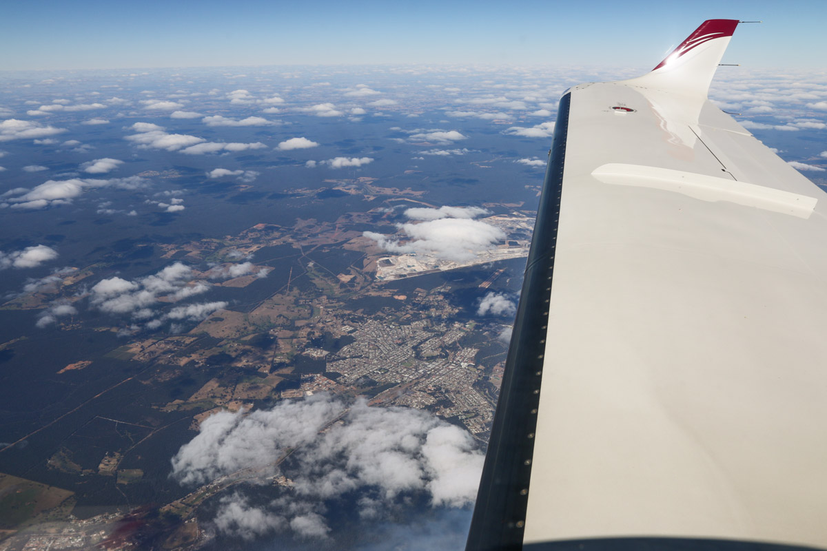Collie, seen from VH-LZJ SOCATA TBM 900 (MSN 1016) owned and flown by Jean-Jacques Bely, – Fri 14 November 2014. Taken from an altitude of 16,500 feet, en route from Manjimup, heading north to Jandakot. View northeast over the town of Collie, with one of the coal mines visible near the centre of photo, ahead of the leading edge of the wing. Photo © David Eyre