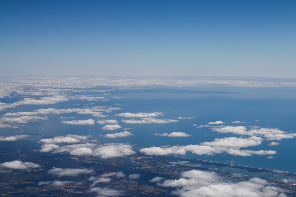 Aboard VH-LZJ SOCATA TBM 900 (MSN 1016) owned and flown by Jean-Jacques Bely, east of Lake Preston and Geographe Bay – Fri 14 November 2014. Taken at 21,000 feet, heading south to Manjimup. This view was taken facing southwest across Geographe Bay. Lake Preston is at lower right. Leschenault Inlet and the City of Bunbury are visible at centre left edge. The peninsula in the distance is Cape Naturaliste, with the twon of Dunsboroughin the centre of photo. Busselton is centre left, but obscured by cloud. Photo © David Eyre
