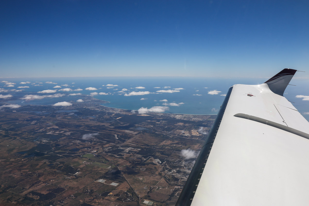 Aboard VH-LZJ SOCATA TBM 900 (MSN 1016) owned and flown by Jean-Jacques Bely, over the town of Serpentine – Fri 14 November 2014. Taken at just over 20,000 feet, heading south to Manjimup. View southwest to the city of Mandurah and Peel Inlet (visible centre left), with Murrayfield Airfield slightly closer to the aircraft. Visible just ahead of the leading edge is Serpentine Airfield. Photo © David Eyre