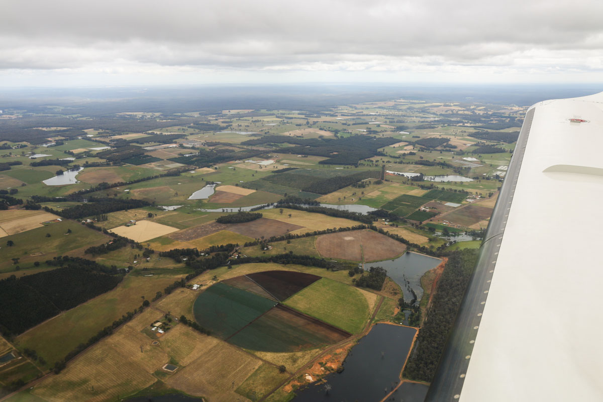 Aboard VH-LZJ SOCATA TBM 900 (MSN 1016) owned and flown by Jean-Jacques Bely, over Linfarne, 7.6km NNW of Manjimup – Fri 14 November 2014. Around 3,000 feet on descent to Manjimup. This view was taken facing west-south-west over Linfarne. Note the circular farm paddock in the foreground. Photo © David Eyre