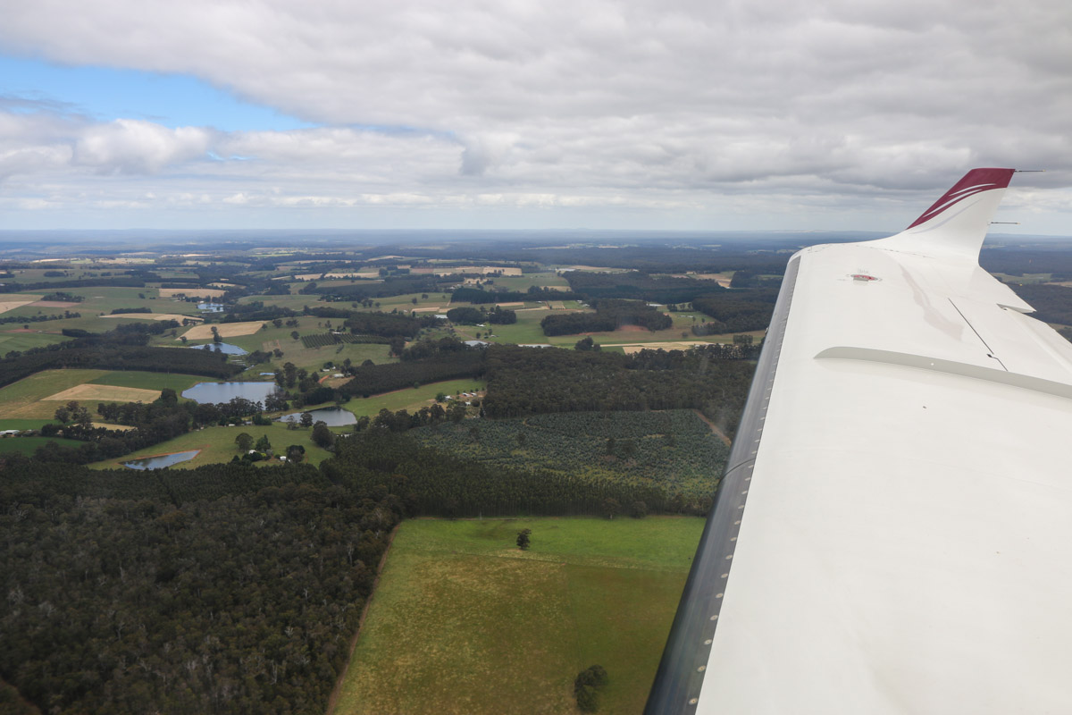 Aboard VH-LZJ SOCATA TBM 900 (MSN 1016) owned and flown by Jean-Jacques Bely, 1km south of Manjimup Airfield – Fri 14 November 2014. About 2,500 feet on descent to Manjimup Airfield. This view was taken facing south-south-east towards the district of Middlesex (Western Australia). Photo © David Eyre