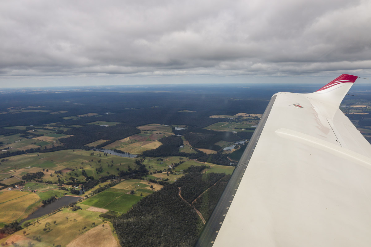 Rural areas NE of Manjimup, seen from VH-LZJ SOCATA TBM 900 (MSN 1016) owned and flown by Jean-Jacques Bely, – Fri 14 November 2014. Taken shortly after take-off from Manjimup, heading north to Jandakot. View northeast from overhead the Manjimup Golf Course, with Wilgarup River visible left of centre. Photo © David Eyre