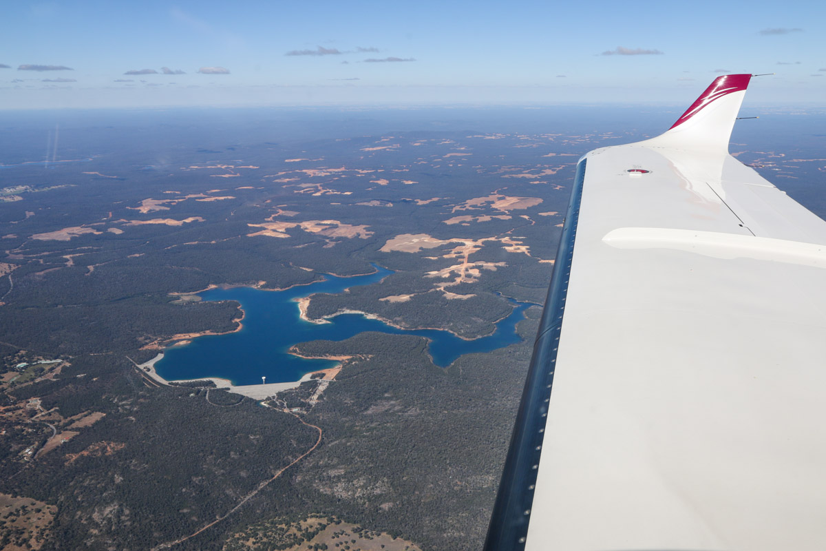 North Dandalup Dam, seen from VH-LZJ SOCATA TBM 900 (MSN 1016) owned and flown by Jean-Jacques Bely, – Fri 14 November 2014. View facing north east. Taken from an altitude of 7,500 feet, on descent to Jandakot, from Manjimup. This dam was built in 1994 and supplies water to Perth. Photo © David Eyre