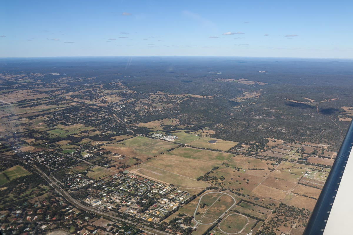 Serpentine town, seen from VH-LZJ SOCATA TBM 900 (MSN 1016) owned and flown by Jean-Jacques Bely, – Fri 14 November 2014. View facing north east. On descent to Jandakot, from Manjimup. Photo © David Eyre