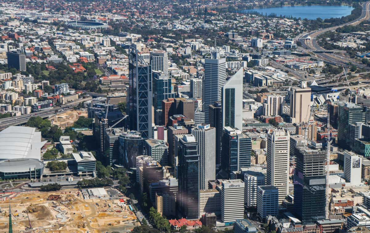 Perth city, seen from VH-ICE Cirrus SR22 GTS G5 (MSN 4063) owned by Andrew Dean - Sat 15 November 2014. View facing west. The sandy area is the site of excavation work to construct Elizabeth Quay. In the distance are Subiaco Oval and Lake Monger. Photo © David Eyre
