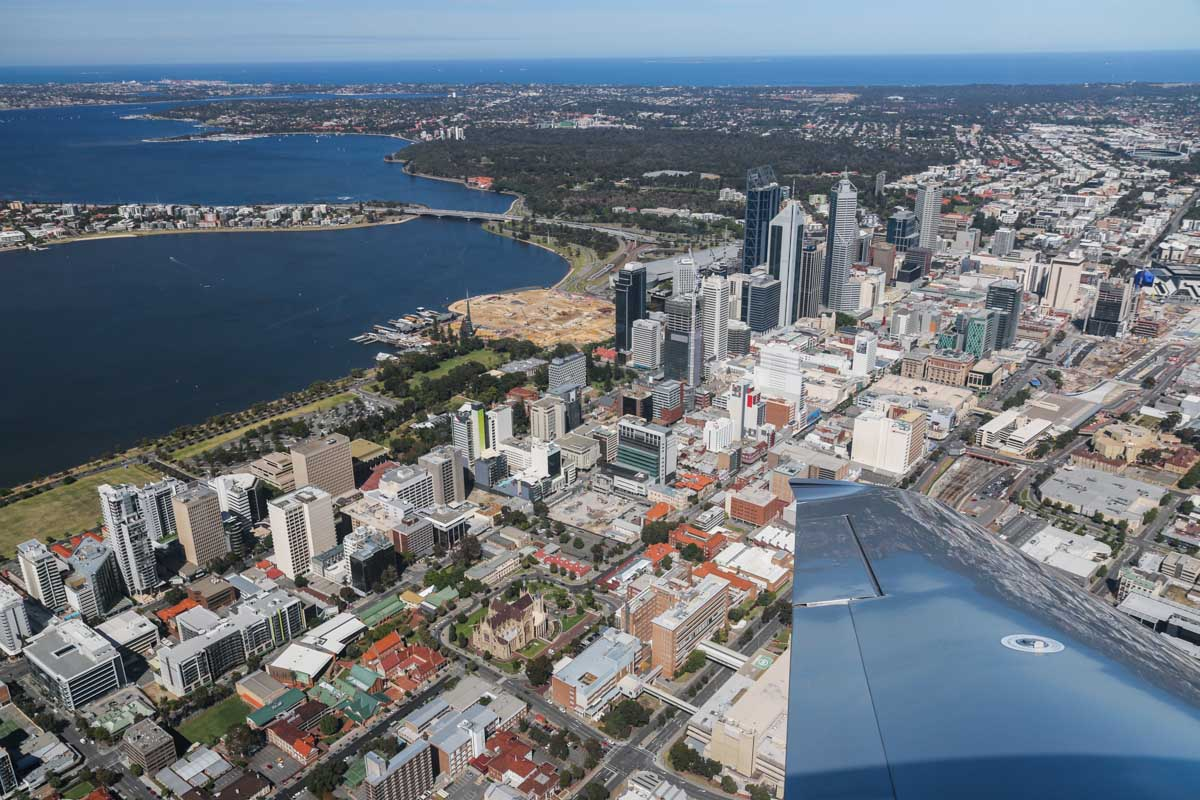 Perth city, South Perth, Swan River, Barrack Street Jetty, and Elizabeth Quay under construction, seen from VH-ICE Cirrus SR22 GTS G5 (MSN 4063) owned by Andrew Dean - Sat 15 November 2014. View facing southwest. Photo © David Eyre