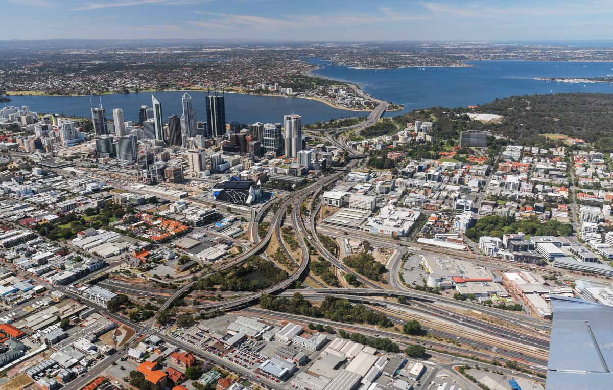 Northbridge, Perth city, South Perth, West Perth, Swan River, and Kings Park, seen from VH-ICE Cirrus SR22 GTS G5 (MSN 4063) owned by Andrew Dean - Sat 15 November 2014. View facing SSW. Mitchell, Kwinana and Graham Farmer Freeways all visible, as well as Perth Arena. Photo © David Eyre
