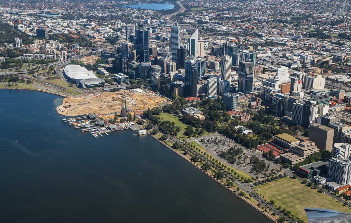 Perth city, seen from VH-ICE Cirrus SR22 GTS G5 (MSN 4063) owned by Andrew Dean - Sat 15 November 2014. View facing northwest. Construction of Elizabeth Quay visible next to Barrack Street Jetty. Photo © David Eyre