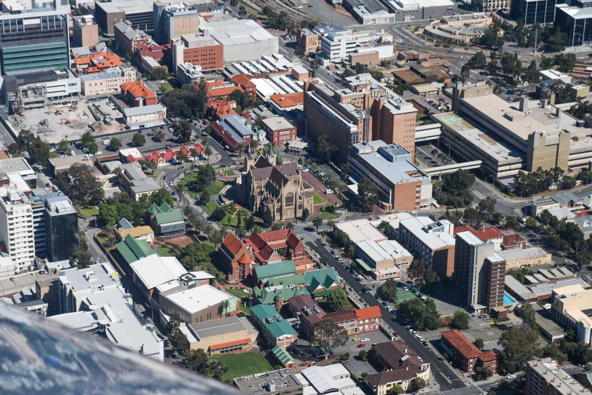 Perth city, seen from VH-ICE Cirrus SR22 GTS G5 (MSN 4063) owned by Andrew Dean - Sat 15 November 2014. View facing northwest. St Mary's Cathedral, with Mercedes College in the foreground and Royal Perth Hospital to the right - the green helipad for the RAC Rescue helicopter is visible. Photo © David Eyre
