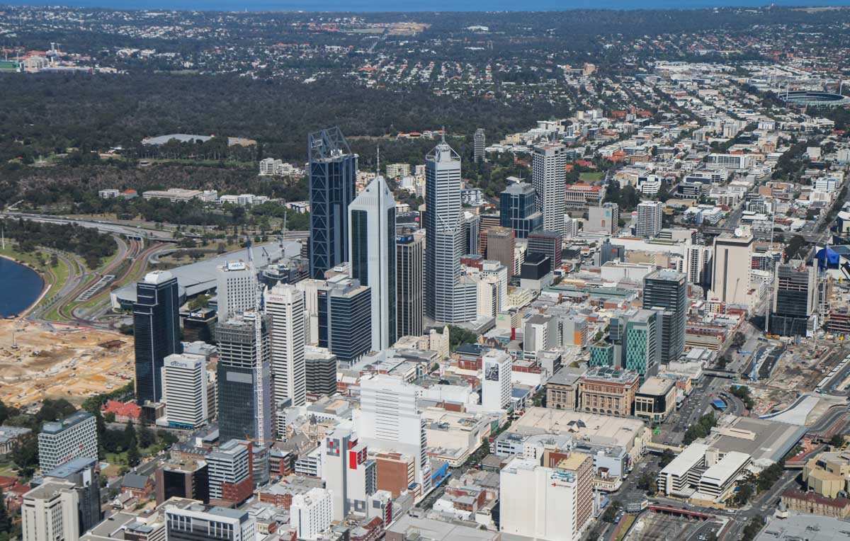 Perth city, seen from VH-ICE Cirrus SR22 GTS G5 (MSN 4063) owned by Andrew Dean - Sat 15 November 2014. View facing WSW. Kings Park, Elizabeth Quay construction, with Subiaco Oval at upper right. Photo © David Eyre