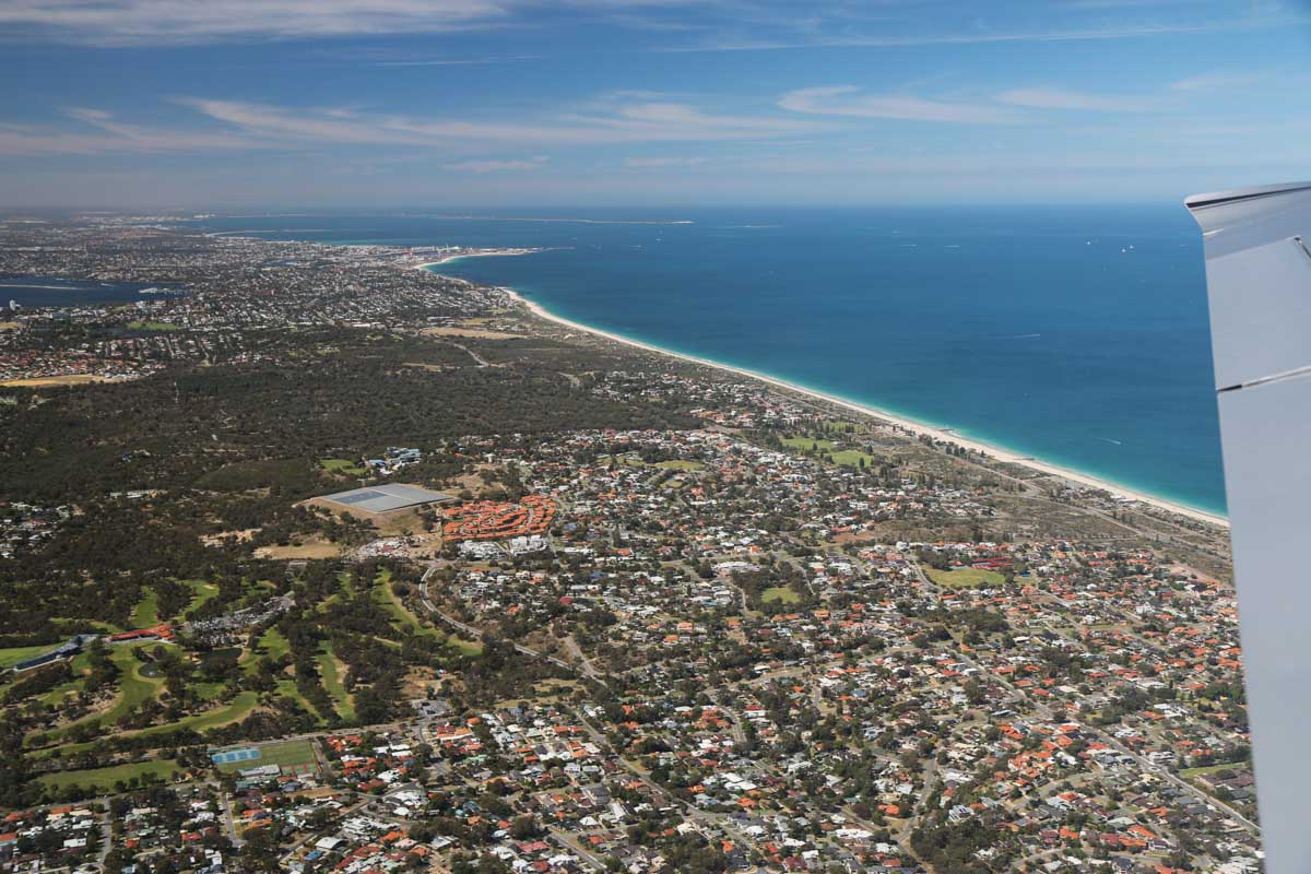 City Beach to Fremantle and Garden Island, seen from VH-ICE Cirrus SR22 GTS G5 (MSN 4063) owned by Andrew Dean - Sat 15 November 2014. View facing south. Photo © David Eyre