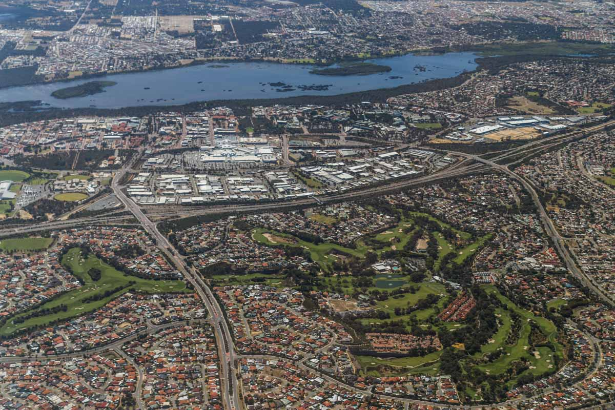 Wanneroo, Lake Joondalup, Joondalup and Connolly, seen from VH-ICE Cirrus SR22 GTS G5 (MSN 4063) owned by Andrew Dean - Sat 15 November 2014. View facing east. Joondalup Shopping Centre and Joondalup Resort and golf course. Photo © David Eyre
