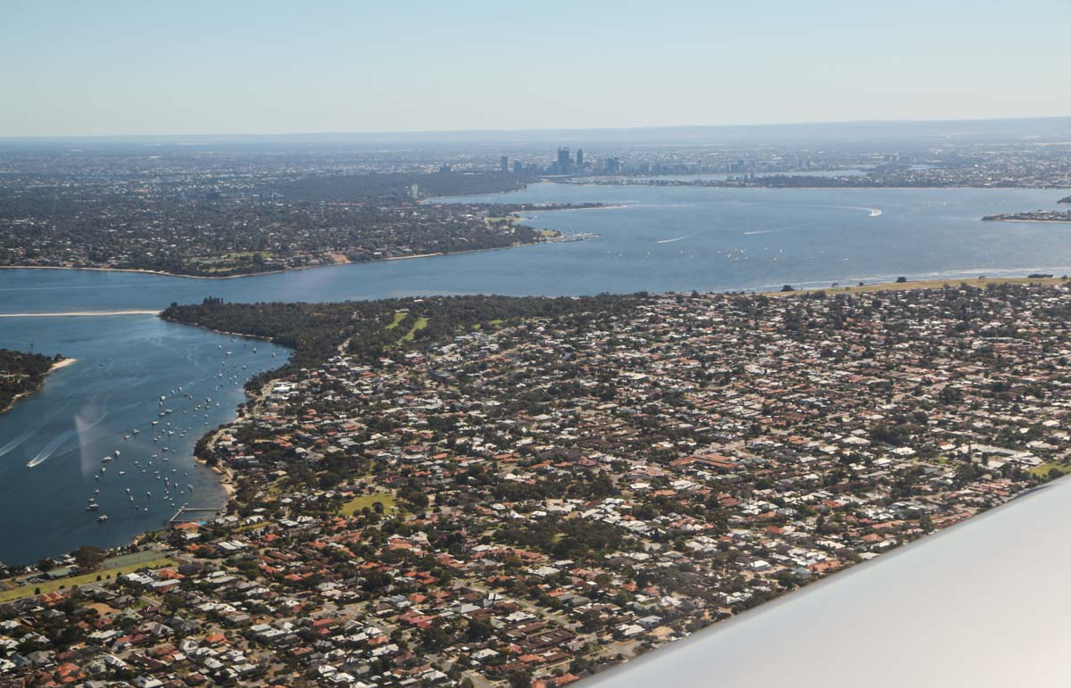 Perth suburb of Bicton on the Swan River, with Perth city in the distance, seen from VH-ICE Cirrus SR22 GTS G5 (MSN 4063) owned by Andrew Dean - Sat 15 November 2014. View facing northeast on a flight from Jandakot to Geraldton, Dongara and back. Photo © David Eyre