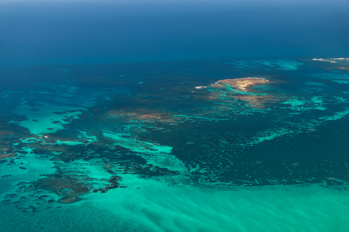 Reefs and islands south west of Dongara, seen from VH-ICE Cirrus SR22 GTS G5 (MSN 4063) owned by Andrew Dean - Sat 15 November 2014. View facing northwest. Photo © David Eyre