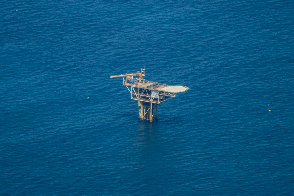 Cliff Head Alpha oil rig near Dongara, seen from VH-ICE Cirrus SR22 GTS G5 (MSN 4063) owned by Andrew Dean - Sat 15 November 2014. View facing west. Roc Oil's Cliff Head Alpha is an unmanned wellhead platform installed in December 2005, at a depth of 18 metres, which pumps oil ashore to a processing plant at Arrowsmith. Photo © David Eyre